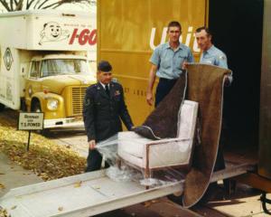Vintage I-Go Van & Storage employees helping move military